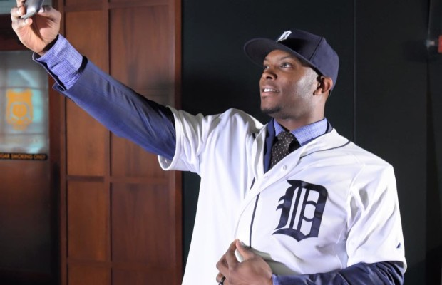 Justin Upton checks out how he looks as a Tiger